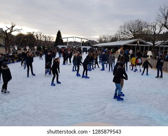 AMSTERDAM, NETHERLANDS - 02 January 2019 Many people skate on winter ice skating rink in front of the Rijksmuseum Amsterdam museum area