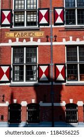 Amsterdam Netherlands 05/05/2014: Fabriek, brickwork and shuttered windows in sunlight