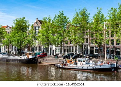 Amsterdam Netherlands 05/05/2014: views of canal with boats bicycles and dutch style houses