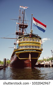 Amsterdam, Netherlands - 08/14/2013 :  The 1990 ship replica of the 'The Amsterdam' owned by Dutch East India Company in front of the National Maritime Museum.