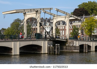 Amsterdam, Netherlands. 08.22.17. Magere Bridge or Skinny Bridge over the Amstel River in the city of Amsterdam. The present bridge was built in 1934. The first bridge at this site was built in 1691.