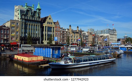 AMSTERDAM NETHERLANDS 10 3 2015: In Europe, some of the finest  examples of houseboats can be seen in canals of Amsterdam, which even has houseboat hotels. Houseboats are very expensive in Amsterdam