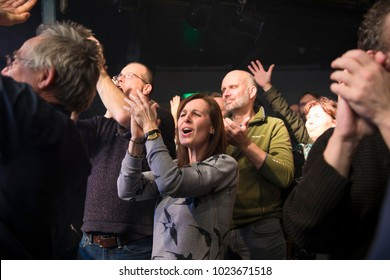 Amsterdam, The Netherlands - 10 february, 2018: audience cheering at concert of Belgian rock band Tjens Matic with singer Arno at venue Melkweg