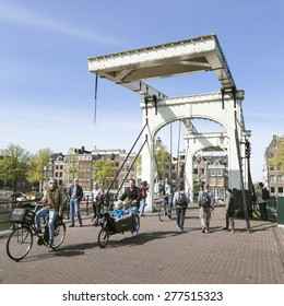 amsterdam, Netherlands, 10 may 2015: boats on amstel and herengracht on a sunny spring morning in amsterdam