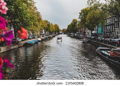 AMSTERDAM, NETHERLANDS - 10.01.2018 - Morning view from brigde on the water channel in Amsterdam. The autumn scene.