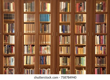 Amsterdam, The Netherlands, 16 september 2017: light brown bookcase with lots of books