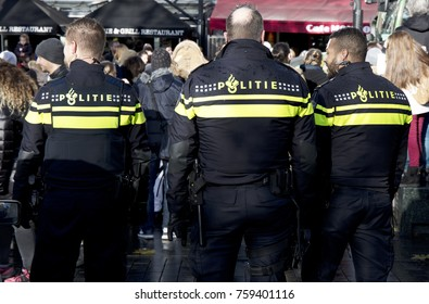 Amsterdam, The Netherlands, 19 november 2017: dutch police officersin the streets of Amsterdam watching a demonstration