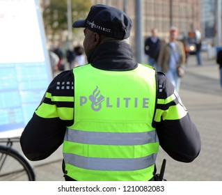 Amsterdam, Netherlands, 19 october 2018: Dutch police officer in the streets of amsterdam
