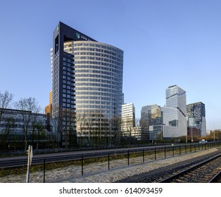 Amsterdam, Netherlands, 2017. Overview of the zuidas, business, legal and finance district of Amsterdam, with the ABN-Amro bank headquarters, Vinoly and The Rock buildings, with railroad and motorway