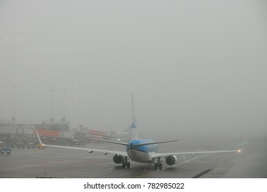 Amsterdam Netherlands 2017, Schipol airport on a misty foggy morning with airplanes stuck at the airport