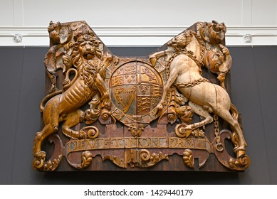 amsterdam, netherlands - 2019.06.14:  rijksmuseum, transom stern carving of the british navy flagship royal charles (1655) captured by the dutch during the river medway raid in 1667