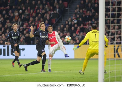 Amsterdam, Netherlands. 20th January 2019. Ajax midfielder Dusan Tadic and Heerenveen defender fights with the ball during the game against ajax and heerenveen for a match in the Dutch first division.