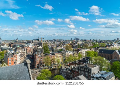 AMSTERDAM, NETHERLANDS - 23 April 2018:Aerial drone bird's eye view of iconic houses in city of Amsterdam