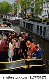 Amsterdam / Netherlands –April 27 2018: Dutch Prime Minister, Mark Rutte on a boat celebrating Kings Day / Koningsdag in the canal of Amsterdam Netherlands