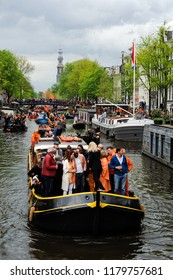 Amsterdam / Netherlands –April 27 2018: Dutch Prime Minister, Mark Rutte on a boat celebrating Kings Day / Koningsday in the canal of Amsterdam Netherlands