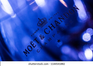 AMSTERDAM, THE NETHERLANDS, 27 JULY 2018 - Extreme closeup of a Moët & Chandon champagne glass in an ice bucket with blue light in the Netherlands