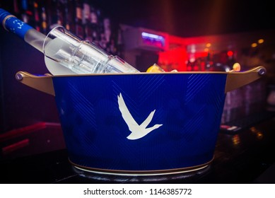AMSTERDAM, THE NETHERLANDS, 27 JULY 2018 -  Big bucket with a 6 liter bottle of Grey Goose Vodka and lime & lemon on the side