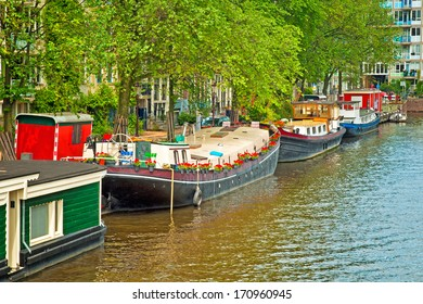 AMSTERDAM, THE NETHERLANDS - 29 JUNE : Canals of Amsterdam on 29 June 2013. Amsterdam is the capital and most populous city of the Netherlands.