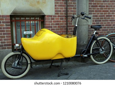 Amsterdam, Netherlands, 30 september 2018: Big wooden shoe on a transport bicycle in Amsterdam