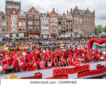 Amsterdam, The Netherlands. 3rd August 2019. Group of gay men and women marching in the boat parade of the Channel Gay Pride