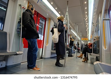 Amsterdam, Netherlands - 8th february 2019: Commuters in the metro on their way to work