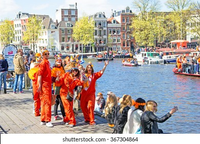 AMSTERDAM, NETHERLANDS - APR 27: People celebrating Kings Day in Amsterdam on April 27. 2015 in the Netherlands