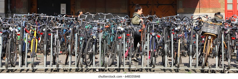 AMSTERDAM, NETHERLANDS - APRIL 04, 2017 : Bicycle traditional street parking in  Amsterdam - bicycle capital of Europe. European tourism
