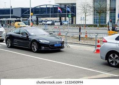 AMSTERDAM, NETHERLANDS - APRIL 12,2018: TESLA MODEL S, A taxi company operating in Amsterdam was an early adopter of electric vehicles and built the largest fleet of Tesla taxis.