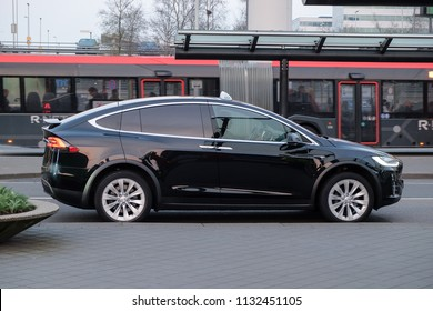 AMSTERDAM, NETHERLANDS - APRIL 12,2018: TESLA MODEL X, A taxi company operating in Amsterdam was an early adopter of electric vehicles and built the largest fleet of Tesla taxis.