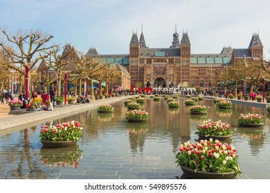 AMSTERDAM, Netherlands - APRIL 13, 2016: Rijksmuseum (National state museum) and city icon I Amsterdam slogan on Museumplein