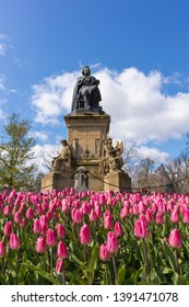 AMSTERDAM, NETHERLANDS - APRIL 13, 2019: Tulips in a Vondelpark, Amastedam on a beautiful blue day. Netherlands
