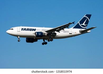 AMSTERDAM / NETHERLANDS - APRIL 15, 2015: TAROM Airbus A310 YR-LCA passenger plane landing at Amsterdam Schipol Airport