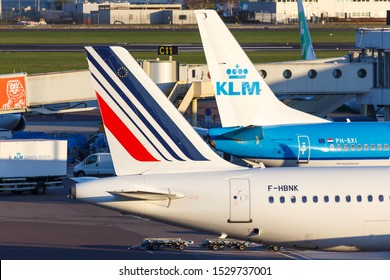 Amsterdam, Netherlands – April 19, 2015: KLM Royal Dutch Airlines and Air France airplanes at Amsterdam Schiphol Airport (AMS) in the Netherlands.
