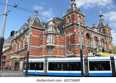 Amsterdam, The Netherlands - April 19, 2017: City theater with tram in Amsterdam