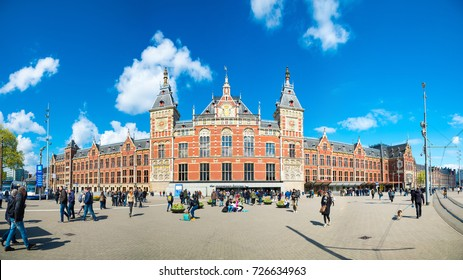 Amsterdam, Netherlands - April 19, 2017: Amsterdam Central Train Station on April 19, 2017 in Amsterdam. Central Station is the main railway station of Amsterdam.