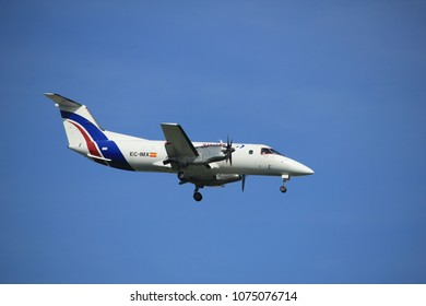 Amsterdam the Netherlands - April, 19th 2018: EC-IMX Swiftair Embraer EMB-120 Brasilia on final approach to Schiphol Polderbaan runway, Amsterdam Airport Schiphol