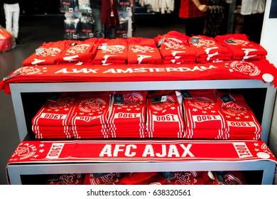 Amsterdam, Netherlands - April, 2017: Ajax fotball club shop interior on Amsterdam Arena, Netherlands. Soccers fan scarves selling
