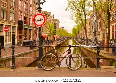 Amsterdam, Netherlands. April 2018 - Beautiful view of the canals in Amsterdam on a cloudy spring day