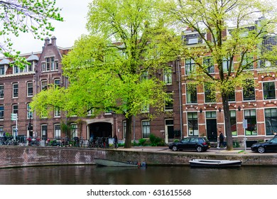 AMSTERDAM, NETHERLANDS - APRIL 21, 2017:   Amsterdam canal and buildings