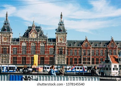 Amsterdam Netherlands April 22, 2019 View of the old Central train station located in Amsterdam during a sunny day in the evening