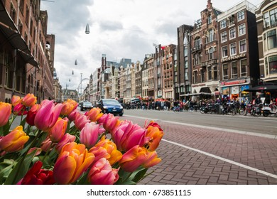 Amsterdam, Netherlands - April, 23, 2017: Street in Amsterdam and people on it in 2017