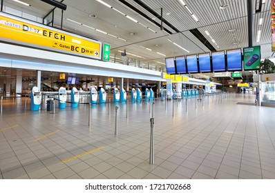 Amsterdam, The Netherlands - April 25, 2020: Amsterdam Airport Schiphol in the Netherlands is virtually empty and abandoned as a result of the corona virus