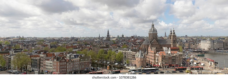AMSTERDAM , THE NETHERLANDS – APRIL 26 , 2018 :Panorama photo of the center of Amsterdam. photo taken from the skylounge terrace.