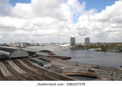 AMSTERDAM , THE NETHERLANDS – APRIL 26  , 2018 : View of the Amsterdam station and part of the IJ and the eye tower