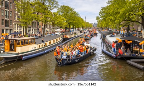 AMSTERDAM, THE NETHERLANDS - APRIL 27 2018: Canal boat parade on Koningsdag Kings day festivities. Birthday of the king.
