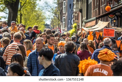 AMSTERDAM, THE NETHERLANDS - APRIL 27 2018: Crowd of people browsing on vrijmarkt flea market on annual Koningsdag. Birthday of the king.
