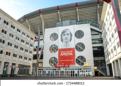 Amsterdam, Netherlands - April 27, 2019: Exterior of the Johan Cruijff Arena from the Zuid H entrance. Home stadium of Ajax Amsterdam football team. Bilboard of former player Cruijff on the arena