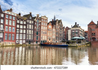 AMSTERDAM, NETHERLANDS - APRIL 29, 2016: Typical old colorful dutch houses standing on the canal