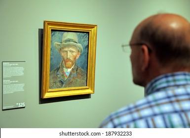 AMSTERDAM, NETHERLANDS - APRIL 3: Man looking at Van Gogh self-portrait picture in Rijksmuseum at city Amsterdam on April 3, 2014 in Amsterdam
