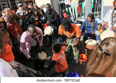 Amsterdam, The Netherlands - April 30, 2013: Street musicians at the celebrations of ( Koninginnedag ) Queen\'s Day is a national holiday in the Kingdom of the Netherlands .